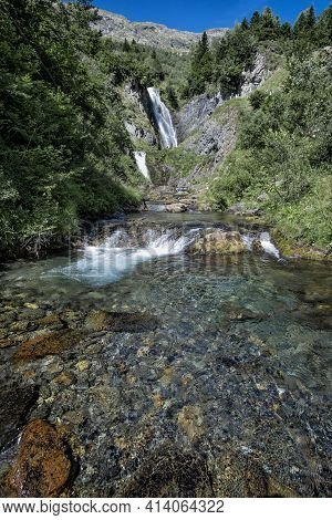 Triple Waterfall In A Mountain River Of Cold, Clear, Transparent And Crystalline Waterswaterfall Of