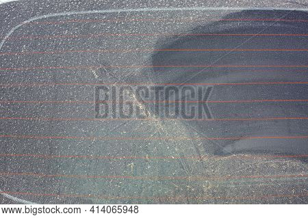 Rear Window Of A Car Covered With A Layer Of Dust After Rain Closeup Of The Windscreen Glass Of A Di