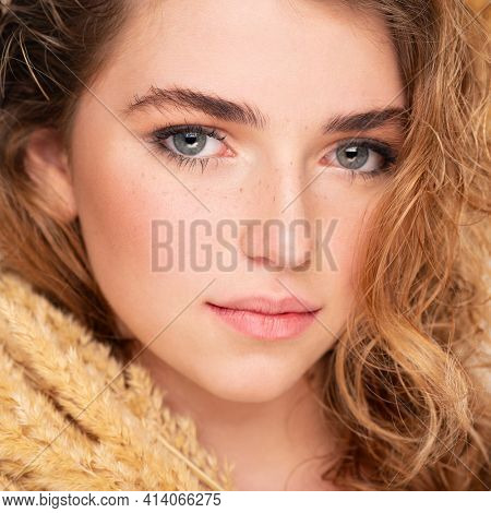 Beautiful young  woman with healthy skin face. Skin care concept. Closeup female face with a freckled. Teen girl with a clean skin of face, isolated.