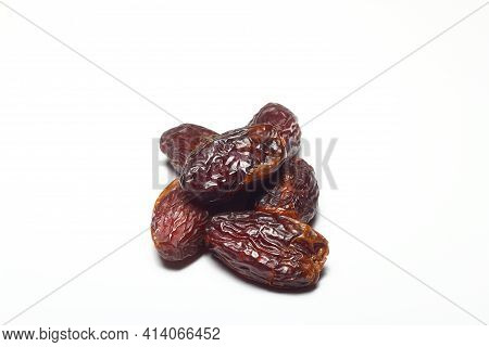 Dates On A White Background. Dried Fruits. Dried Dates Lie Next To Each Other