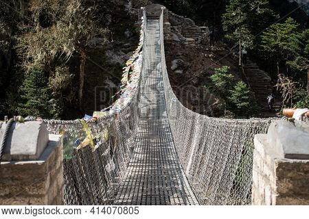 View Of The Suspension Bridge Using For Crossing The River In Sagarmatha National Park, Nepal. Suspe
