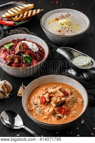 Various Soups, Traditional Beetroot Soup With Meat, Soups With Mushrooms, Seafood On Dark Wooden Bac