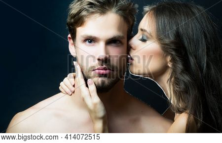 Closeup Portrait Of Young Couple Kiss. Sexy Woman Embracing And Kissing Muscular Man. Sensual Kisses