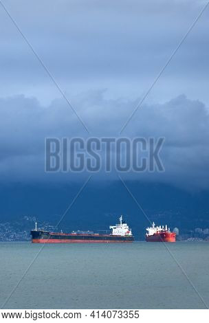 English Bay Freighters Storm Clouds. Freighters Under Storm Clouds In English Bay.
