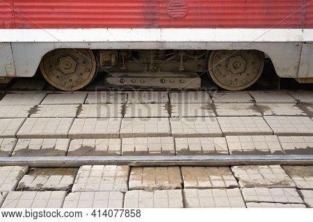 Red Old City Tram, Rusty Wheels. Broken Tram Tracks Outside
