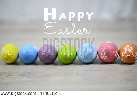 Happy Easter. Soft Bright And Colorful Easter Eggs Lined Up Horizontally On A White Wooden Backgroun