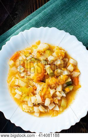 Mix Of Stewed Vegetables On A White Plate In Cafe. Vegetable Stew In Tomato Sauce. Cooked Vegan Or V