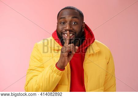 Charming Happy Young African-american Bearded Guy In Yellow Jacket Red Hoodie Prepare Lovely Birthda