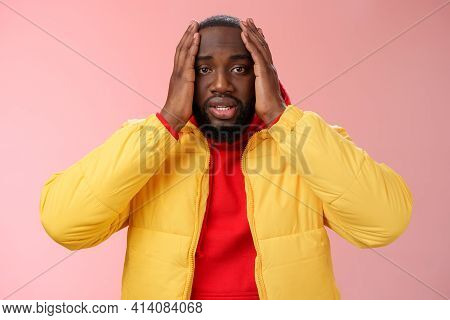 Shocked Upset African-american Bearded Guy Feel Regret Stunned Hear Terrible News Hold Hands Head Wi