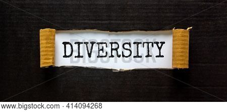 Diversity And Inclusion Symbol. The Word 'diversity' Appearing Behind Torn Black Paper. Beautiful Bl