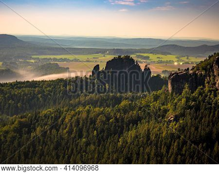 The Rauschenstein Rock Formations In Moon Light. Rocks Above Elbe River In An Area Known As Saxon Sw