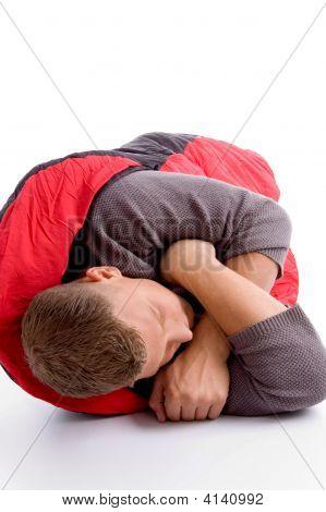 Man Taking Rest In His Sleeping Bag