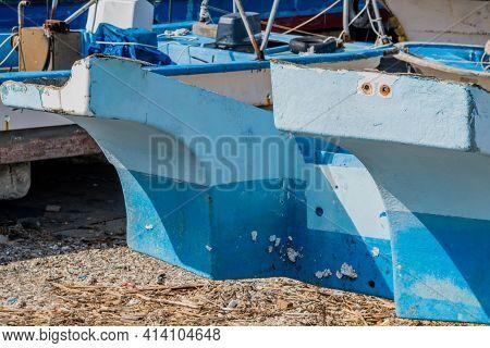 Closeup Of Fiberglass Hull Of Scrapped Fishing Trawler.