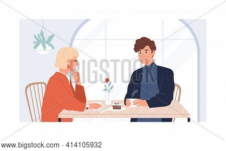 Couple Of Young Man And Woman Sitting And Talking In Modern Cafe On Date. Meeting Of Two People For
