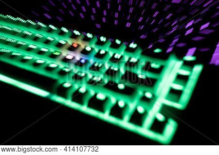Out Of Focus Top View Detail Closeup Of Two Illuminated Mechanical Gaming Rgb Keyboard With Keycaps