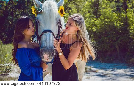 Women Enjoying Horse Company .mom And Girl With A Nice Horse, Stylish Ladies At Countryside Outdoor,