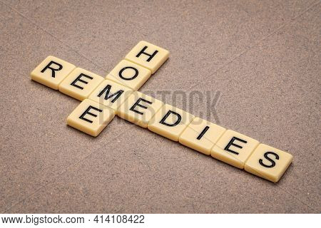 home remedies crossword in ivory letter tiles against textured paper, lifestyle and self care concept