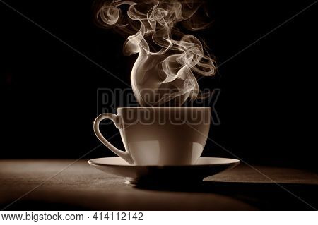 Hot Coffee In Coffee Cup On A Table. A Red Cup Of Tasty Coffee. Light Atmosphere. Copy Space.