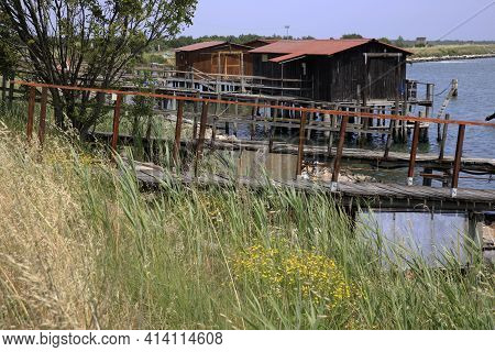 Po River (fe),  Italy - April 30, 2017: Fisherman\'s Houses On Po River, Delta Regional Park, Emilia