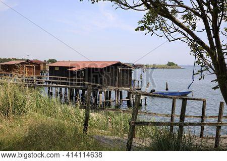 Po River (fe),  Italy - April 30, 2017: Fisherman\\\'s Houses On Po River, Delta Regional Park, Emil
