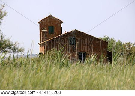 Po River (fe),  Italy - April 30, 2017: Fisherman's Houses On Po River, Delta Regional Park, Emilia