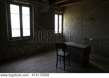 Po River (fe),  Italy - April 30, 2017: A Old Chair And Table In A Fisherman\'s Houses Inside On Po