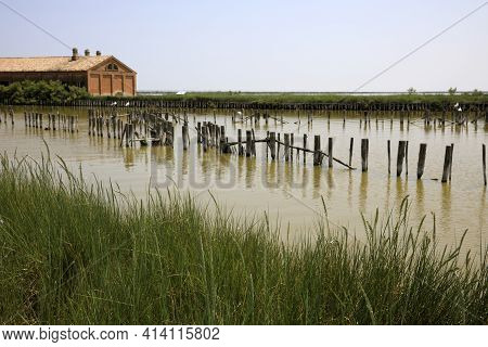 Po River (fe),  Italy - April 30, 2017: An Old Fisherman's House On Po River, Delta Regional Park, E