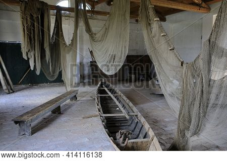 Po River (fe),  Italy - April 30, 2017: Nets And Boat Into An Old Fisherman's House On Po River, Del
