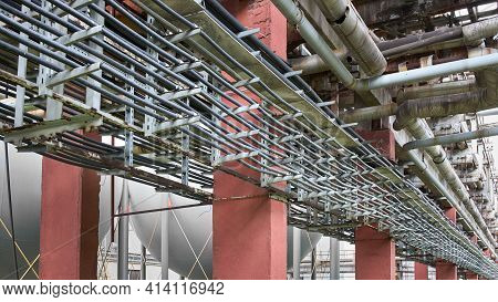 Cable Route On Steel Supports. Rows Of Parallel Power Cables Laid In Route For Power Supply Of Petro