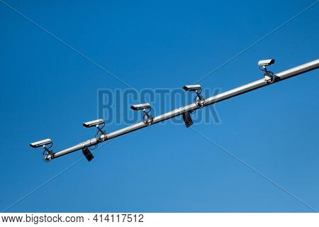 Five Cctv Cameras Mounted On The Mast Of The Road Post. 4 Cameras Are Looking In The Same Direction