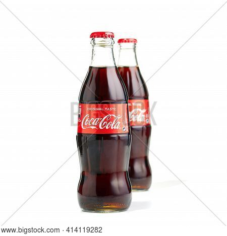 Estonia, Tallinn - 25.03.2021: Coca-cola Classic In A Glass Bottle Isolated On White. Two Bottles Of