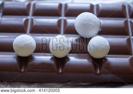 Homemade Chocolate Truffles With Cocoa Powder. Closeup View. Tasty Sweet Chocolate Truffles.