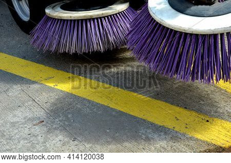 Outdoor Sweeper. Using Round Brushes With Plastic Purple Brushes. Cleaning Gravel And Clutter In The