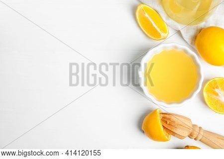 Freshly Squeezed Lemon Juice On White Wooden Table, Flat Lay. Space For Text