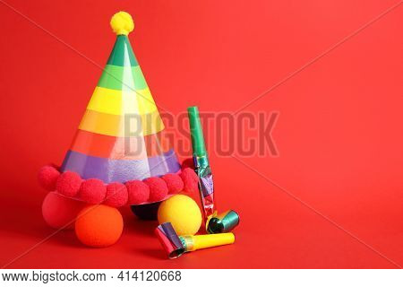 Party Cap, Blowers And Clown Noses On Red Background, Space For Text