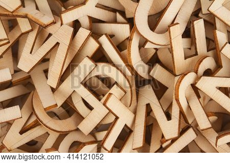 Top View Closeup Detail Macro Of Pile Of Wooden Cut Small Alphabet Letters
