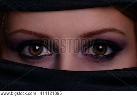 Close Up Portrait Of A Gorgeous Female Face With Crystal And Shiny Eyes With Beauty Make Up, Wearing