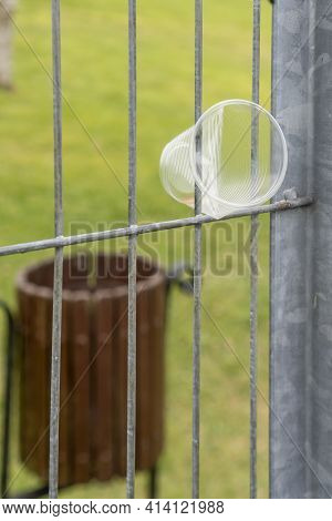 Environmental Pollution, Plastic Cup Close-up In The Cell Of The Mesh Fence