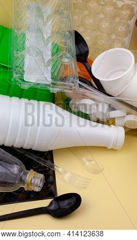 Waste Sorting. Plastic Waste For Recycling. Bottles, Containers, Forks, Spoons, Egg Packaging, Lids.
