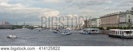 Saint-petersburg, Russia - July 10, 2020: The Excursion Boats On The Neva River Sail To The Pier On