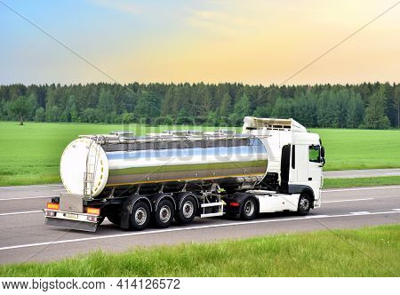 Isothermal Tank Truck Driving On Highway. Oil And Gas Transportation And Logistics. Metal Chrome Cis