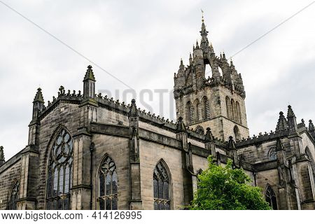 Old Building Of St Giles Cathedral On The Historic Royal Mile Street And Area, In A Cloudy Summer Da