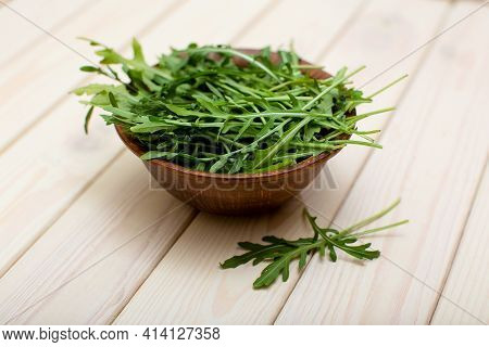 Fresh Green Aragula Or Rucola Leaves Salad In Bowl Close-up