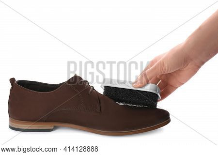 Woman Cleaning Suede Leather Shoe On White Background, Closeup. Footwear Care Accessory