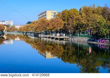 Bucharest, Romania, 22 November 2020 - Dambovita River, Old Buildings And Yellow, Orange And Brown L