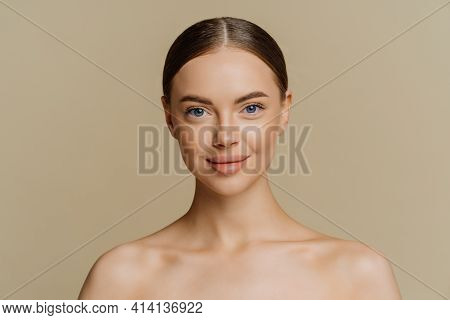 Indoor Shot Of Beautiful Young Woman With Combed Hair Stands Half Naked Indoor Has Natural Beauty Is