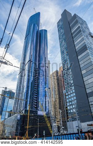 Melbourne, Australia - May 13, 2019: Street View Of Modern High-rise Buildings In Diminishing Perspe