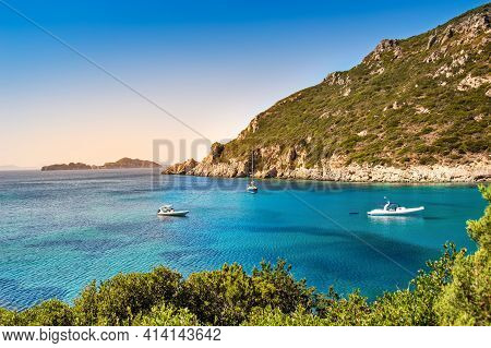 Boats In Bay Near Porto Timoni Beach On Corfu Island In Greece. Beautiful View Of Greek Coast With G