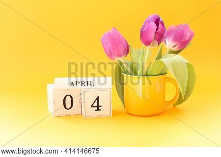 Calendar For April 4: Cubes With The Numbers 0 And 4, The Name Of The Month April In English, A Bouq