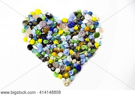 Colorful Bright Buttons In The Form Of A Heart On A White Background. Old Vintage Buttons Close-up.